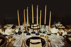 In love with this #tablescape, especially the tall skinny gold candles.