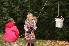 Simple pulley Play idea for toddlers.  Strap a bucket over a tree branch. playground, kids and pulleys, play spaces, play sets, tree houses, tree branches, play ideas, outdoor play, backyard play
