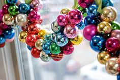 'Thread ornaments onto ribbon for a shiny, awesome swag. i seriously love this idea. so pretty!'
