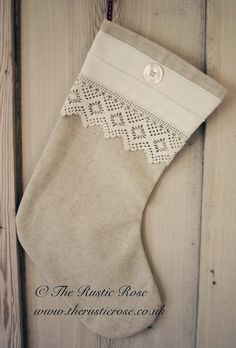 We made this stocking from linen, vintage tablecloth and old button...