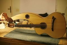 The Harp guitar is the grandaddy of all multi necked guitars. It is unusual to find a lefty.