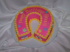 Pink horseshoe birthday cake.