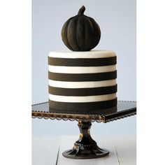 The darkness dazzles on this black and white Halloween design. The striped round cake is topped by a black fondant-covered topper baked in Wilton's Dimensions® Multi-Cavity Mini Pumpkins Pan. halloween mini, cakesmi style, cake wilton, beauti cake, cake halloween, halloween design, wedding cakes, mini cakes, halloween cakes