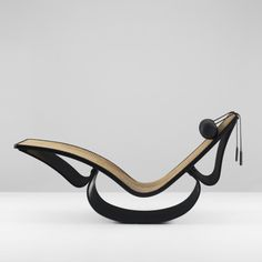OSCAR NIEMEYER    Rio chaise lounge    Brazil, c. 1978  lacquered wood, cane, leather  68 w x 23.75 d x 33.5 h inches