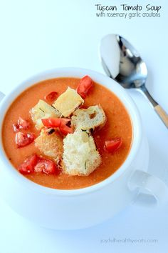 A hearty Tuscan Tomato Soup with Homemade Rosemary Garlic Croutons! | www.joyfulhealthyeats.com | #wintersoup #souprecipes #vegetarian #freezerfriendly