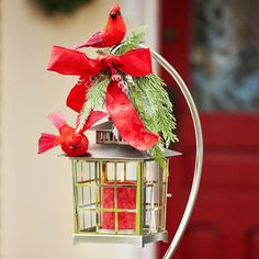 Outdoor decor for Christmas - lantern on plant hanger w/ greenery and Cardinals