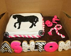 Cowgirl cake by Gina  Sugar cookie name, fondant rope & boots. The horse and wagon wheels made of royal icing