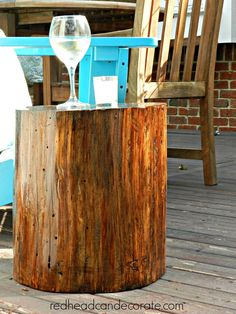 DIY Stump Table {Our elm tree was dead.  We had to cut it down.  I picked one of the stumps.  Hubby sanded it just a little.  Then we brushed it with polyurethane.  It's gorgeous & almost free}
