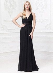 Elegance is an understatement in this truly breathtaking crinkle chiffon deep V-neck dress!  Spaghetti strap crinkle chiffon dress features eye-catching deep V-neck bodice.  Draped cinched waist and sheer fabric paneling detail creates a stunning and elongated silhouette.  Sheer lace back with covered buttons finishes off the look.  Available in Black. Sizes 0-14.  Fully lined. Side zip. Imported polyester. Dry clean.