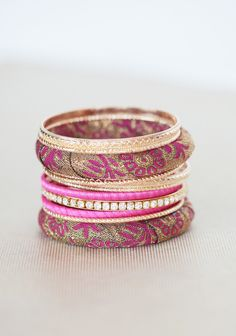 """Fairest Beauty Bangle Set 16.99 at shopruche.com. Taken from the pages of a classic fairy tale, this set of eleven bangles exudes romance with sparkling rhinestone, a golden hue, and delightful fabric wrapped styles. Perfect for mixing and matching.2.75"""" diameter"""