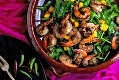 Exotic grilled shrimp with wilted spinach and peaches. Photo: Andrew Scrivani for The New York Times
