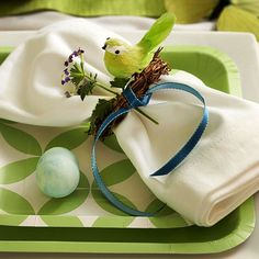 Give your Easter table a springy feel with a nature-inspired place setting. More Easter decorating ideas: http://www.bhg.com/holidays/easter/decorating/easter-table-setting-ideas/?socsrc=bhgpin031313springsetting