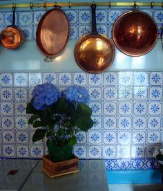 beautiful tiles, and copper pans