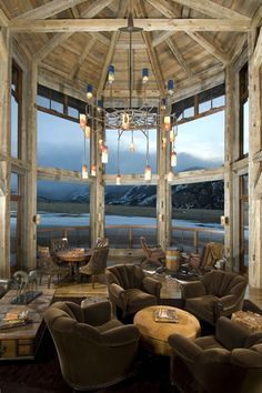 Reclaimed barn and log home along the Beartooth Foothills in Montana.  What amazing windows and views in this rustic vacation home.