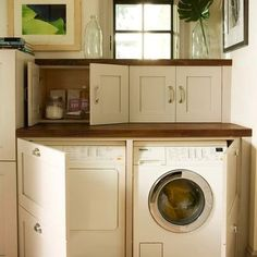 Love those little cabinets over the washer counter...
