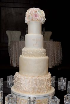 Shades of blush pearls demask and ruffled petals adorned this towering wedding cake. pearl demask, blush pearl, wedding cakes, shade, glam cake, cake glam