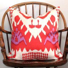 Quadrille Kazak Ikat pillow cover in Orange and Magenta