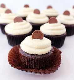 Reese's Peanut Butter Cup Cupcakes – moist chocolate cupcakes stuffed with a Reese's Peanut Butter Cup and frosted with Peanut Butter Buttercream.
