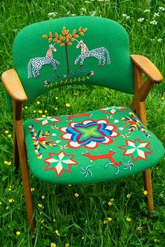 Swedish contemporary embroidery by Elin Jantze on upholstery fabric with inspiration from traditional Scandinavian embroideries on petersham wool  