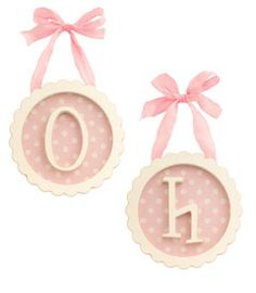 Instead of $44 each, I think I would make these using frames, scrapbook paper, wooden letters, and ribbon to hang with.