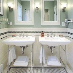 vintage-looking bath with console sinks