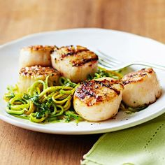 So many great low cal recipes here. Grilled Scallops with Almond-Arugula Pesto  Delicious 350-Calorie Dinners. Thanks Family circle!