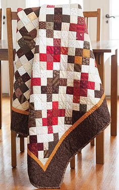 And a puzzle it is! The trick to laying out the Four Patch blocks is to find the rhythm in the diagonal rows. Just be sure the browns are connected to the browns and the reds to the reds. This quilt, Four Patch Puzzle by Maria Umhey, is fat-quarter friendly.