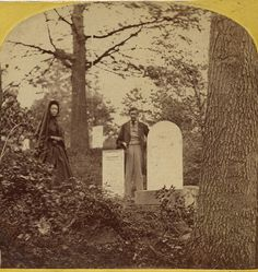 """""""This undated and unidentified stereo card seems very personal. I do not think it was a commercial product but made for a specific family on a visit to the family plot. A woman in mourning dress and man holding a top hat stand by two grave stones. The inscription on the larger stone is not readable but portions of the smaller stone tell a sad but common story. """"John H"""" and """"Infant Son of..."""" can be read."""""""