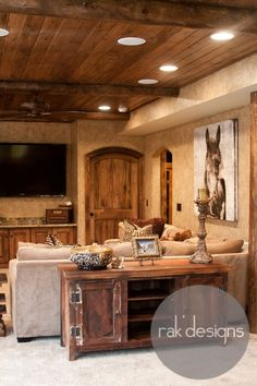 Cool Ceiling design for man cave. And great door.
