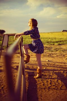 Cowboy boots with a cute sundress and a belt create the perfect country chic