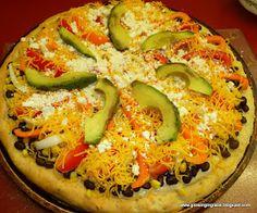 Black bean and avacado pizza with homemade crust. @amazingavocado #holidayavacado