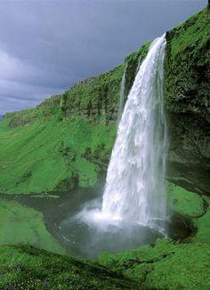 Beautiful waterfall...Mossy surroundings. Iceland