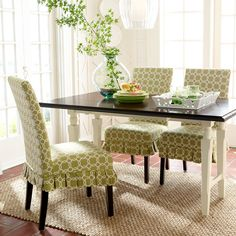 Breakfast nook with slipcovered chairs #diningroom
