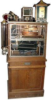 """1923 """"Butter-Kist"""" machine by Holcomb & Hoke - pops corn and butters it in view of customer"""