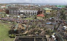 The devastation caused by Typhoon Haiyan, are seen Sunday, Nov. 10, 2013, in Tacloban city, Leyte province in central Philippines. Typhoon Haiyan, one of the most powerful storms on record, slammed into six central Philippine islands on Friday, leaving a wide swath of destruction and scores of people dead. (AP Photo/Toti Navales)