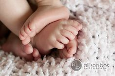 awww! newborn twin feet!