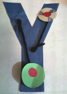 Alphabet Craft For Kids.  Alphabet Letter Y is for Yo-yo!  This easy-to-make Letter Y is for Yo-yo craft is a ton of fun and