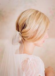 soft bun with a veil. beautiful!