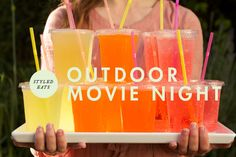 Outdoor movie night (printable popcorn bags, mini candy bars, sodas). sheet + projector + speakers + blanket =awesome