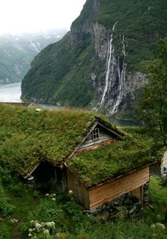 House, waterfall, & fjord in Norway