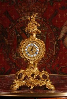EARLY ORMOLU ANTIQUE FRENCH ROCOCO BOUDOIR TABLE CLOCK BY HENRY MARK, PARIS.