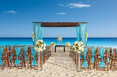 This beautiful blue wedding decor at Secrets Capri RIviera Cancun really complements the turquoise backdrop. #beachweddings