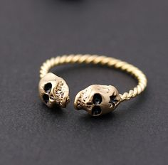 twisted ringline, skull ring, in gold