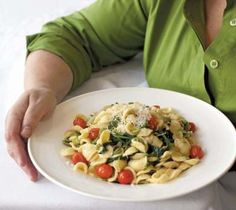 Yum and perfect for spring! Orecchiette with Favas and Tomatoes.