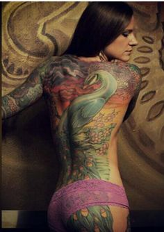 feminine peacock color body tattoo http://blog.tattoodo.com/2014/04/40-enticing-peacock-tattoos/