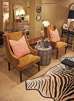 Zebra #hide #rug and upholstered #arm #chairs room design with #geometric #toss #pillows #Chicago #Mecox #interiordesign #MecoxGardens #furniture #shopping #home #decor #designidea #vintage #antiques #garden