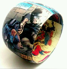 Comic Book Bracelet-I think I could do this with napkin rings, comics, and modge podge!