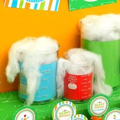 Science Party Decorations - Make decorations using a glass beaker, construction paper, and cotton. Great decoration for Workshop of Wonders VBS. #firstpresorangeburgvbs