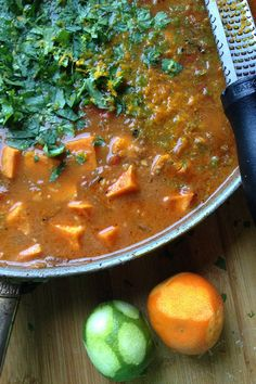 Sweet Potato Soup Recipe packed with fresh cilantro with a peanut butter base. reluctantentertainer.com