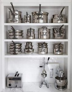 mauviel stainless steel pots via Ciao Bella!